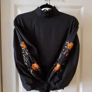 Beautiful embroidered high neck blouse